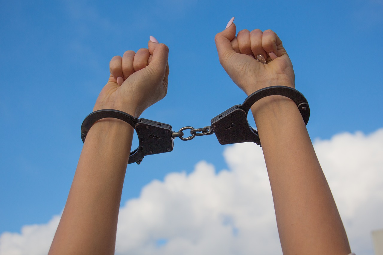 sky hands in handcuffs female hands free photo