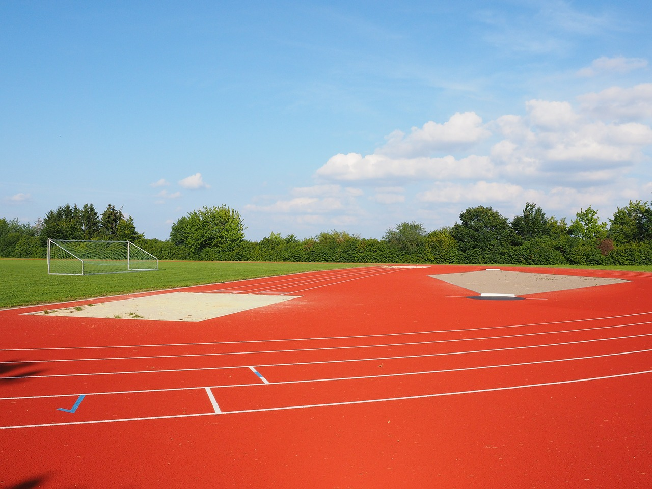 sports ground football field long jump free photo
