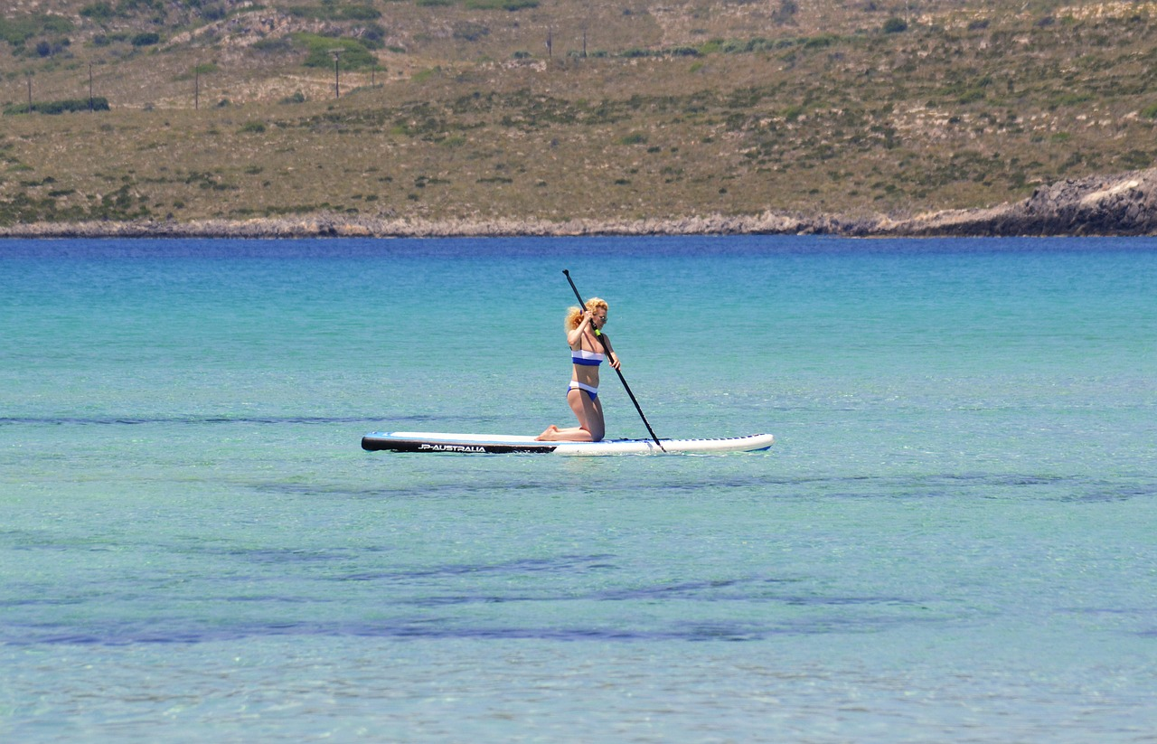 stand up paddle board water sports woman free photo