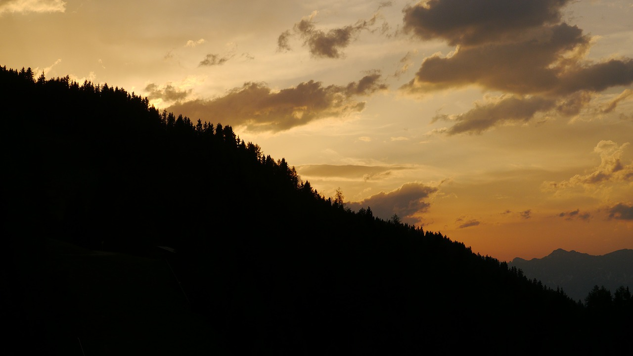 sunset in the evening mountains free photo