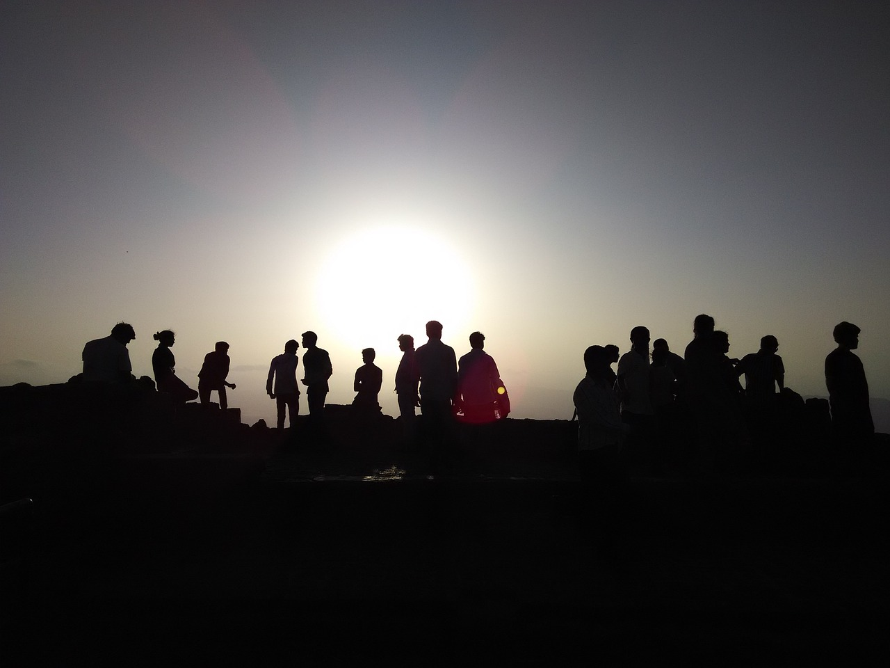 sunset crowd silhouette silhouette free photo