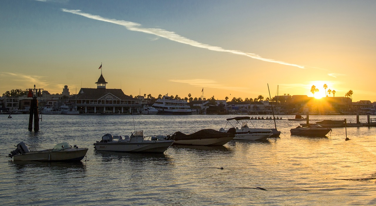 sunset,beach,boat,sea,vacation,water,sunrise,summer,travel,sun,horizon,coast,landscape,shore,evening,orange,silhouette,color,romantic,yellow,outdoor,sunlight,balboa,newport beach,free pictures, free photos, free images, royalty free, free illustrations