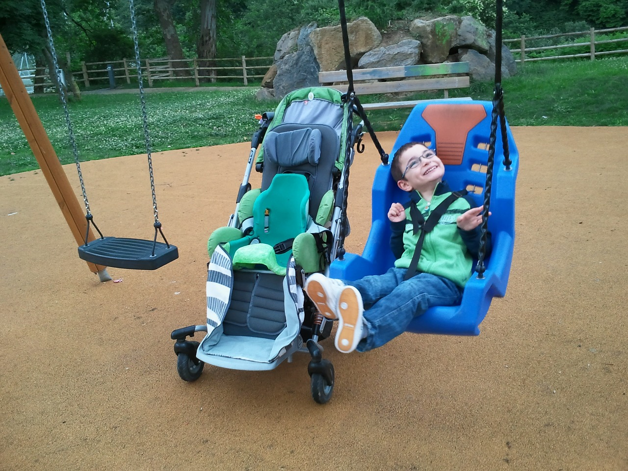 Child,swing,disability,guy,smiles - free image from needpix.com