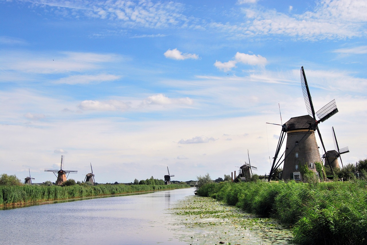 the windmills kinderdijk river free photo