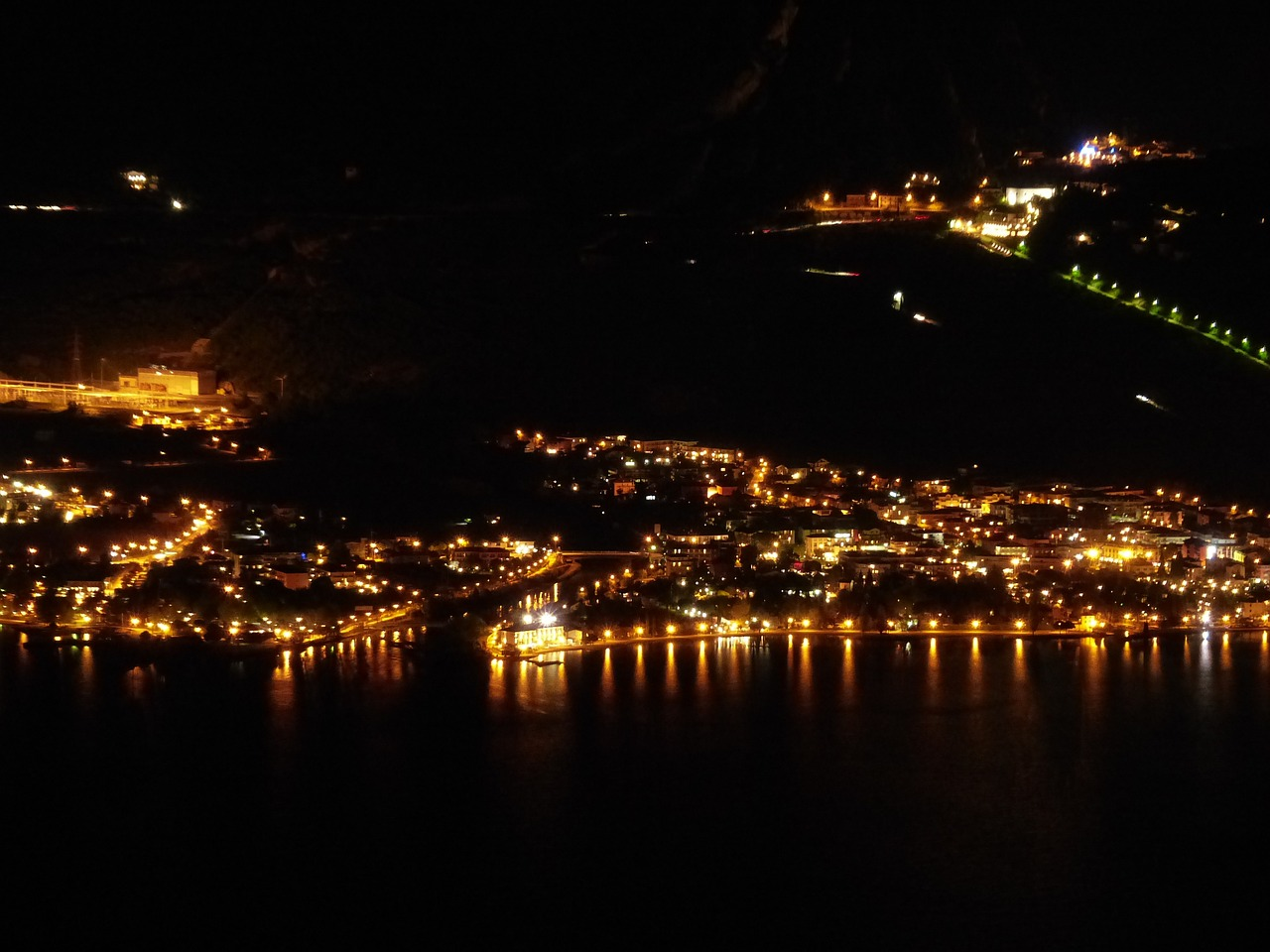torbole at night coast line free photo