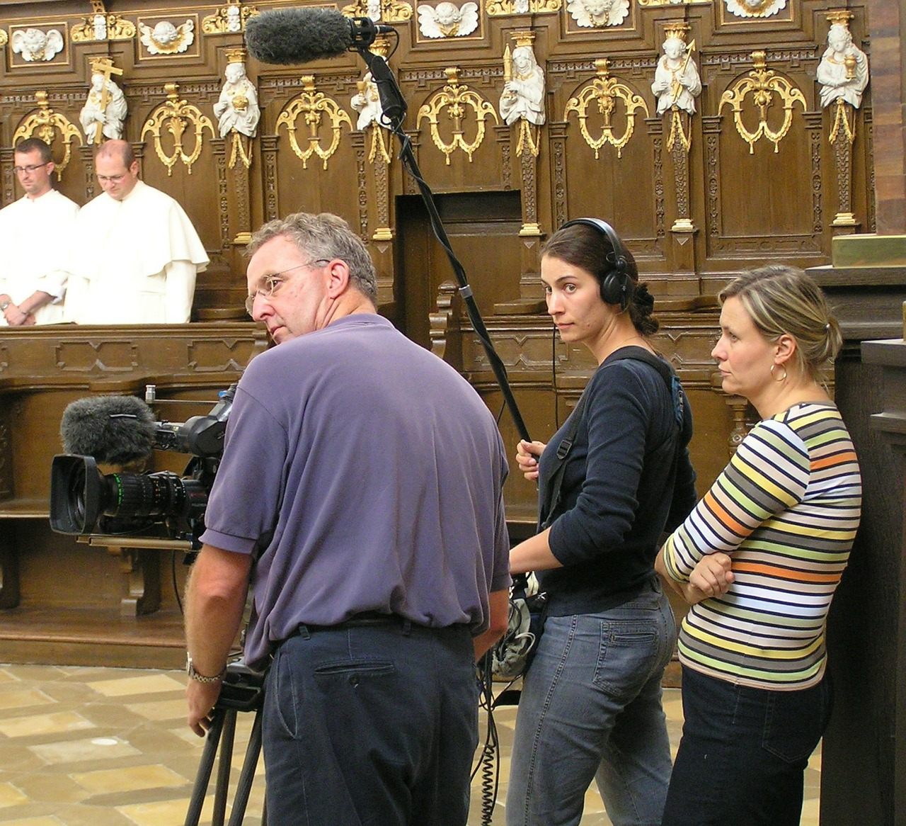 tv crew turning choir stalls free photo