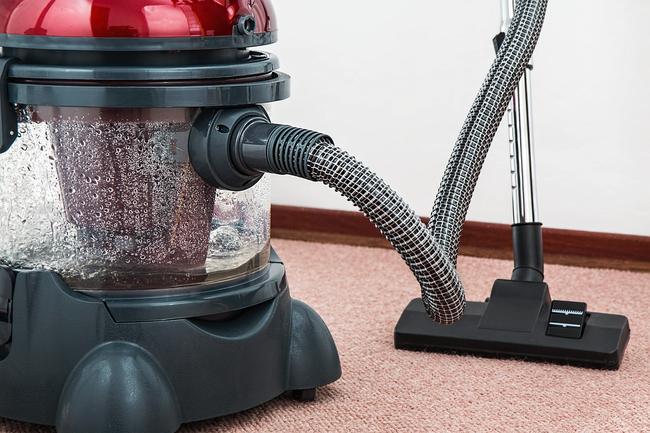 vacuum pump to clean carpet from grease