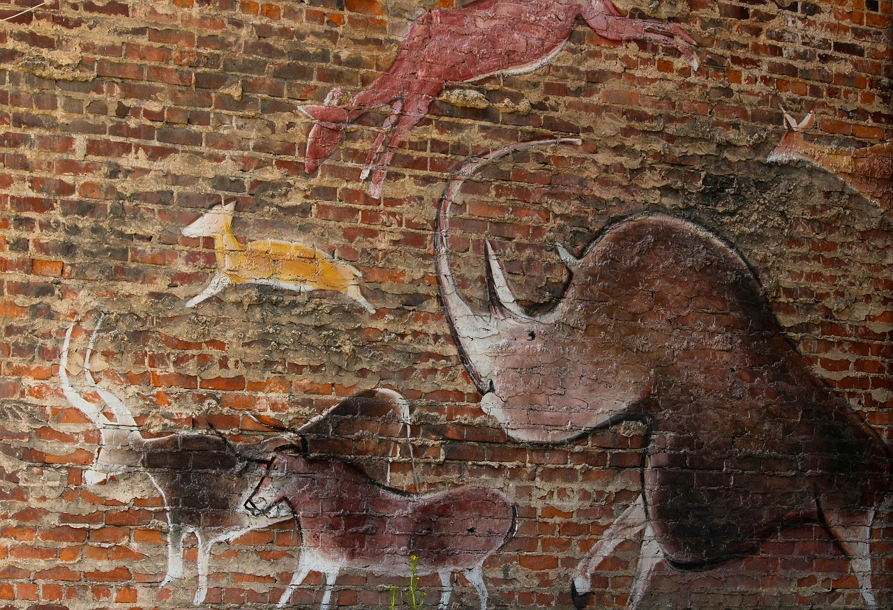 wall mural prehistoric style street art free photo