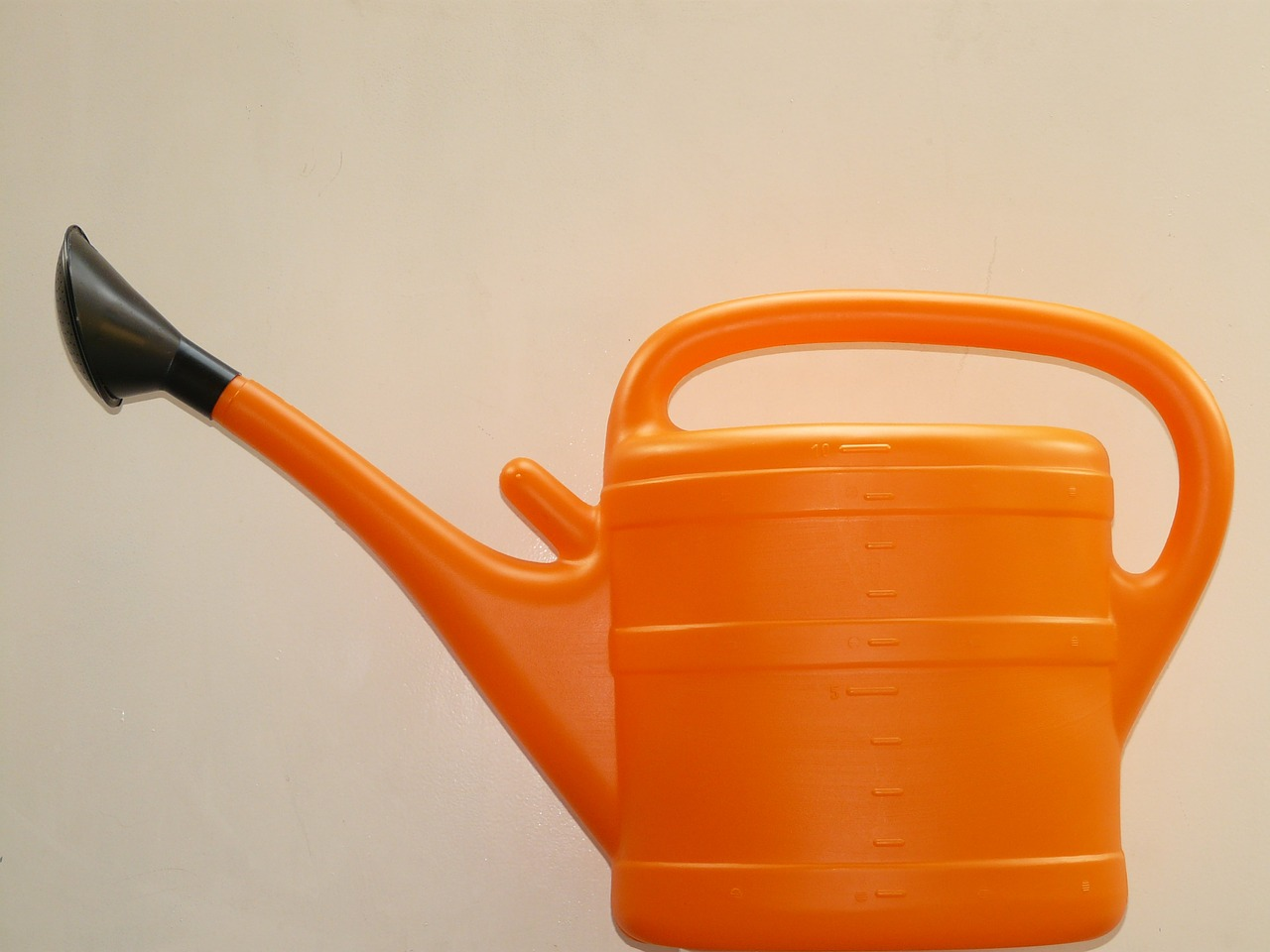 watering can casting orange free photo