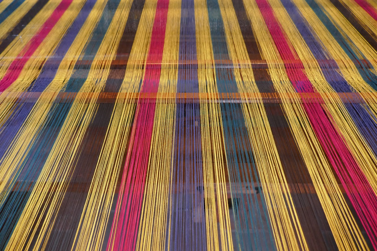 weaving mill  weft threads  loom free photo