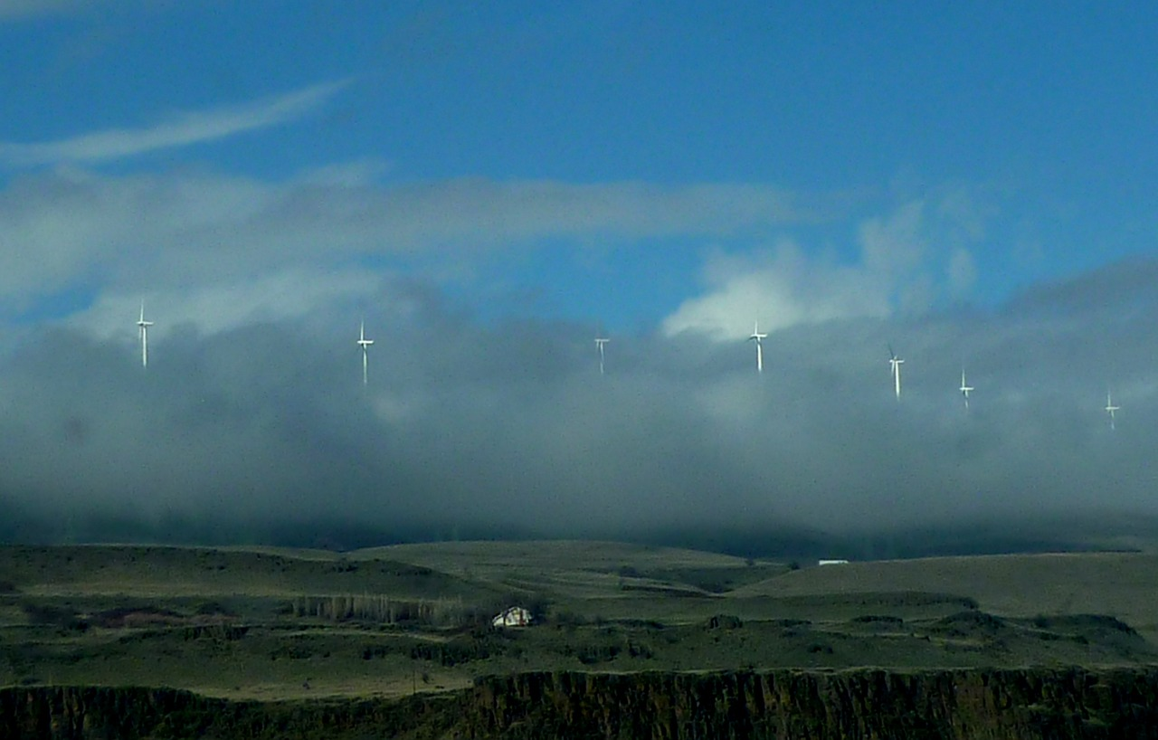 windmills low clouds sky free photo