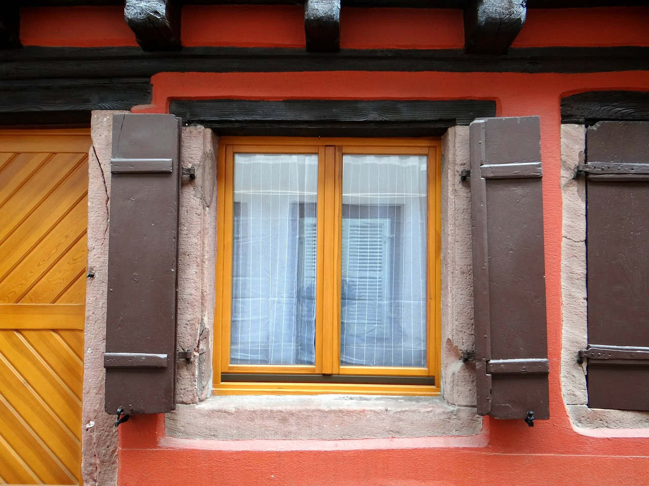 window,shutters,mirroring,truss,picturesque,individual,red,yellow,brown,fachwerkhaus,old town,historically,home,alsace,colmar,france,free pictures, free photos, free images, royalty free, free illustrations, public domain