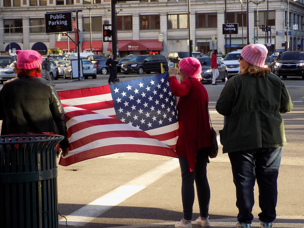 women u s flag protest free photo