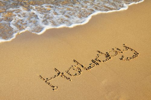 Word Holiday In Sand