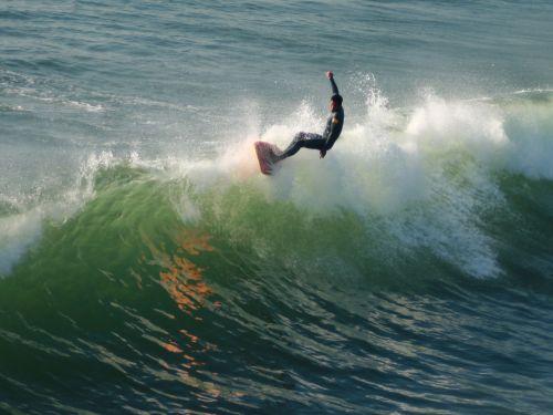 Longboard Surfer On The Wave Crest