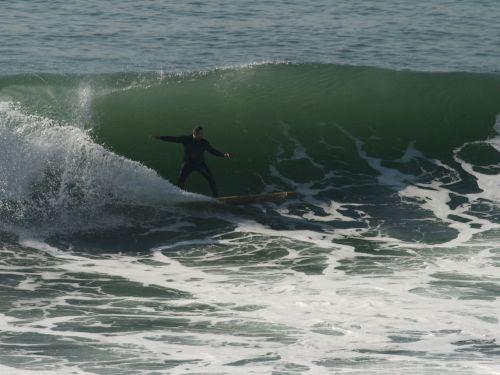 Longboarder Shoots A Curl