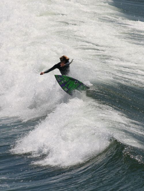 Surfer Smashes The Curl