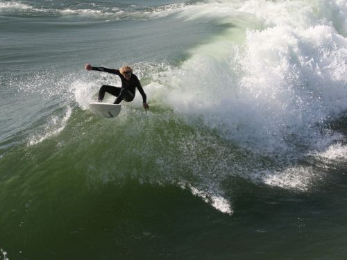 Surfer Goes For The Top End Turn