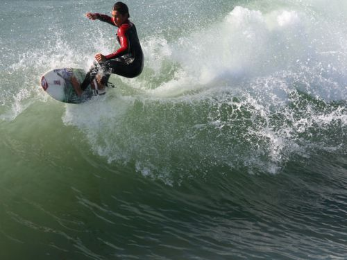 Surfer Carves To The Wavecrest