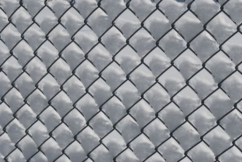 Snow In The Fence