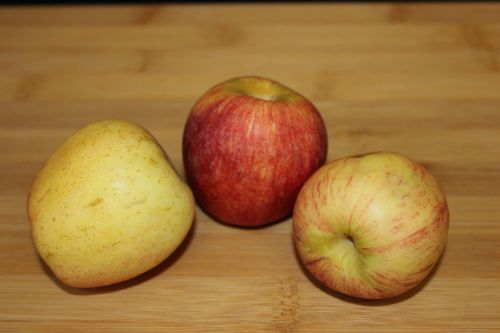 3 Apples On A Chopping Board