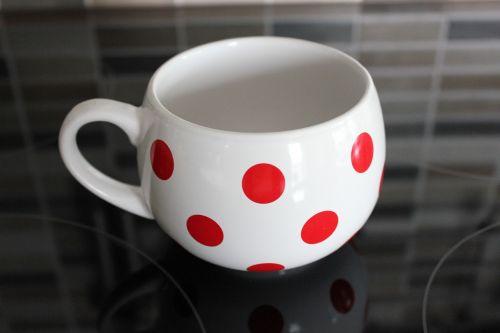 a cup of ceramics dot
