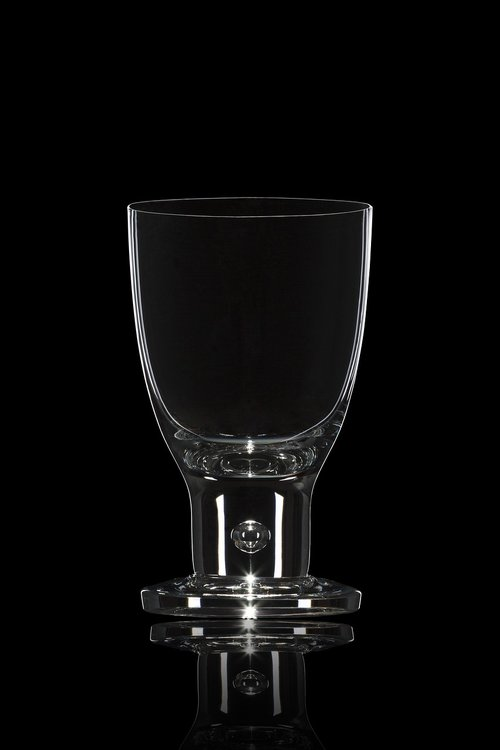 a glass of  transparent  handicraft