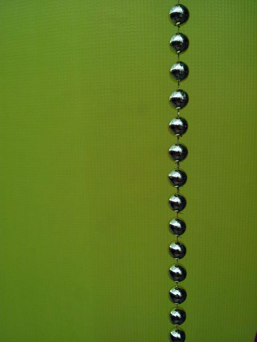 A String Of Balls On Green