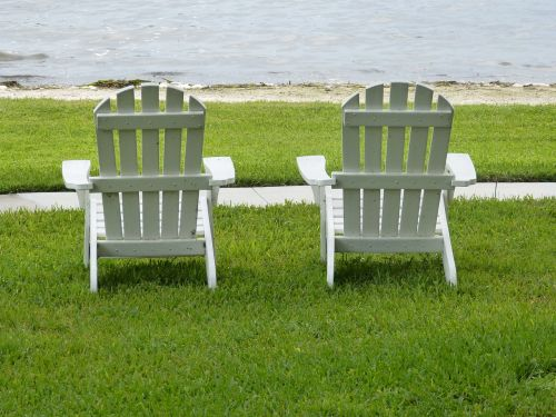 adirondack chairs lake relaxing
