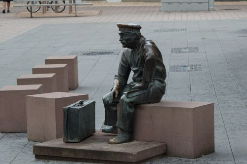 adult sculpture sit