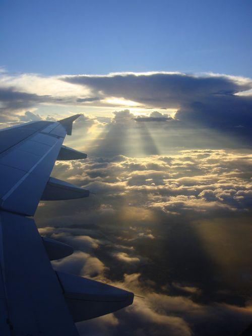 aircraft sunrise clouds