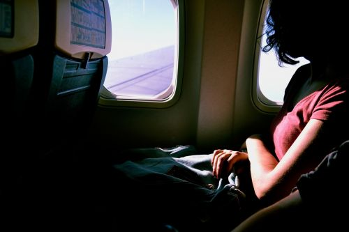 airplane,travel,flight,seat,window,anticipation,person,woman,business travel
