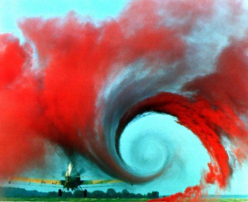 airplane vortex wings red smoke