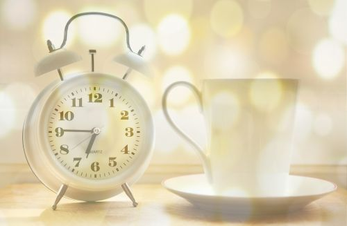 alarm clock coffee cup time of