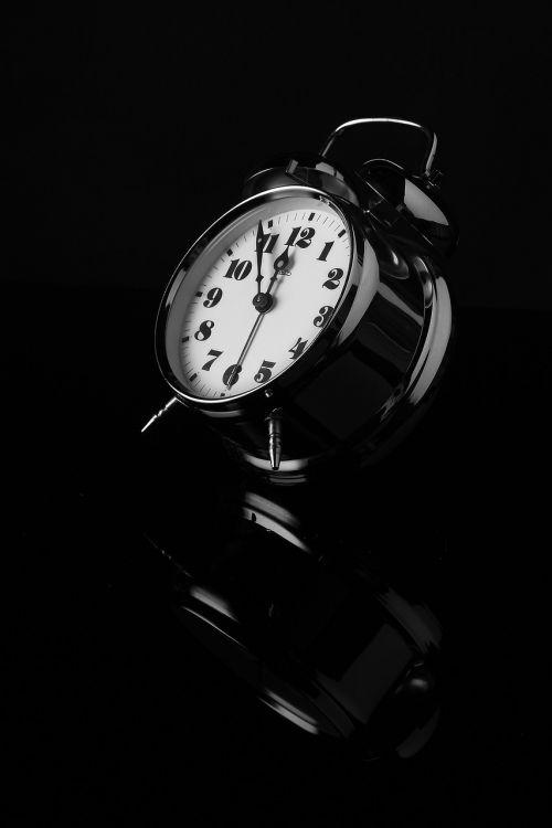 alarm clock black and white reflection
