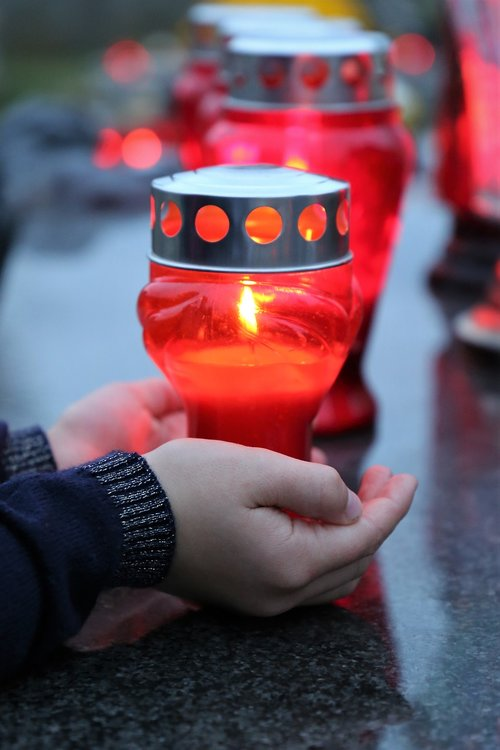 all saints  candle in child hands  condolence