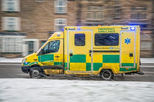 Ambulance Driving In A Winter