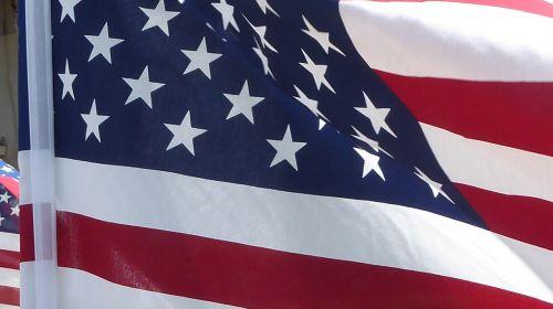 american flag unfurled flying