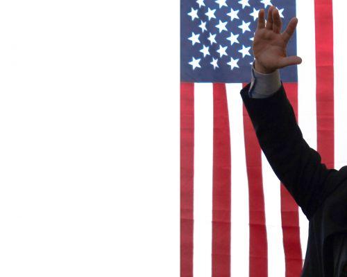 American Flag Hand Raised