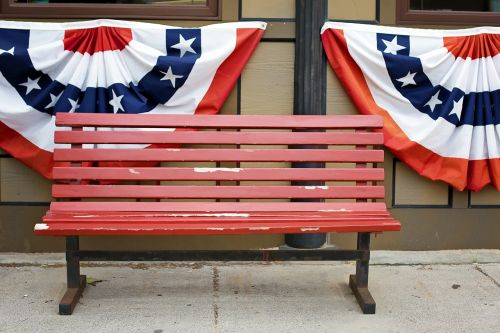 american flags bunting red bench