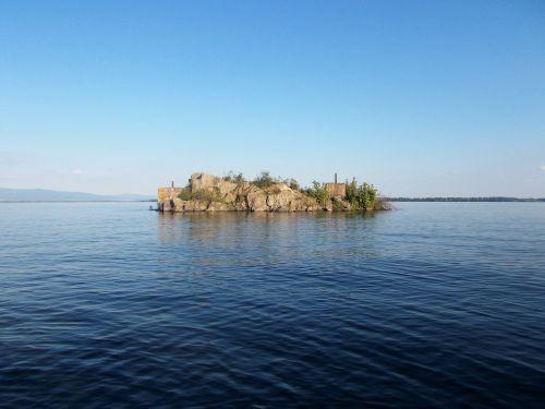 an island water sun