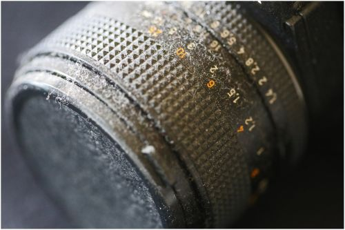 analog photography,dusty,old,antique,metal,mechanically,discarded camera,close up,discarded,unused