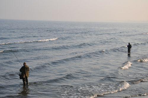 angler fishing sea