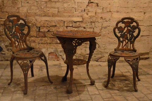antique cast iron pans table and chairs