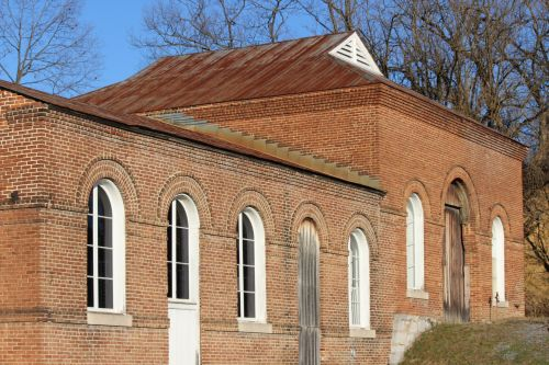 Antique Brick Building With Arches