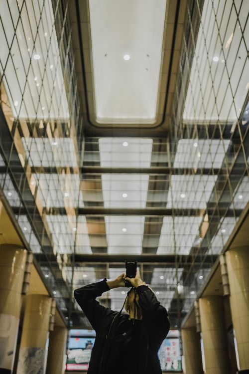 architecture,building,infrastructure,indoor,glass,reflection,people,man,photographer
