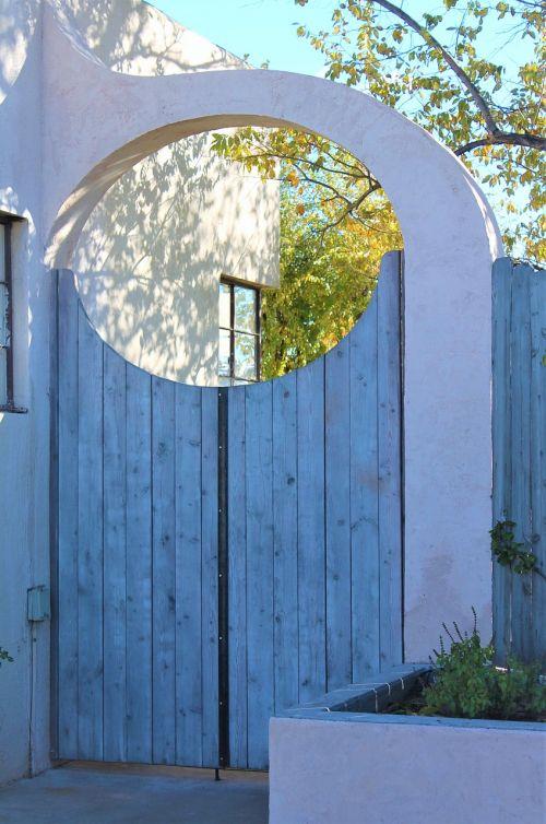 archway adobe wooden gate