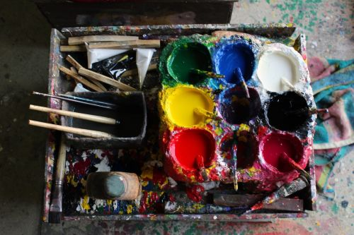 Artist's Paint Pots And Brushes