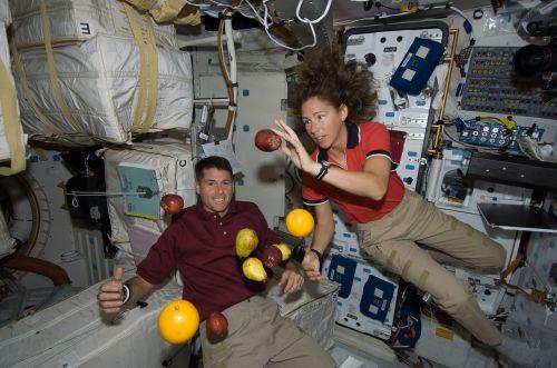 astronauts floating fruit