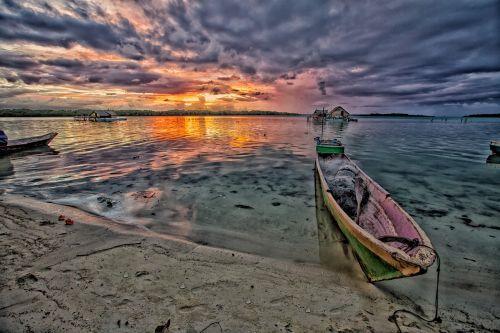 at dusk lagoon dugout canoe
